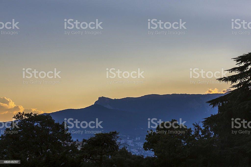 highest mountain at sunset stock photo