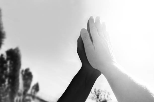High-five black and white hands stock photo