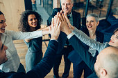 istock High-five for success! 925075258