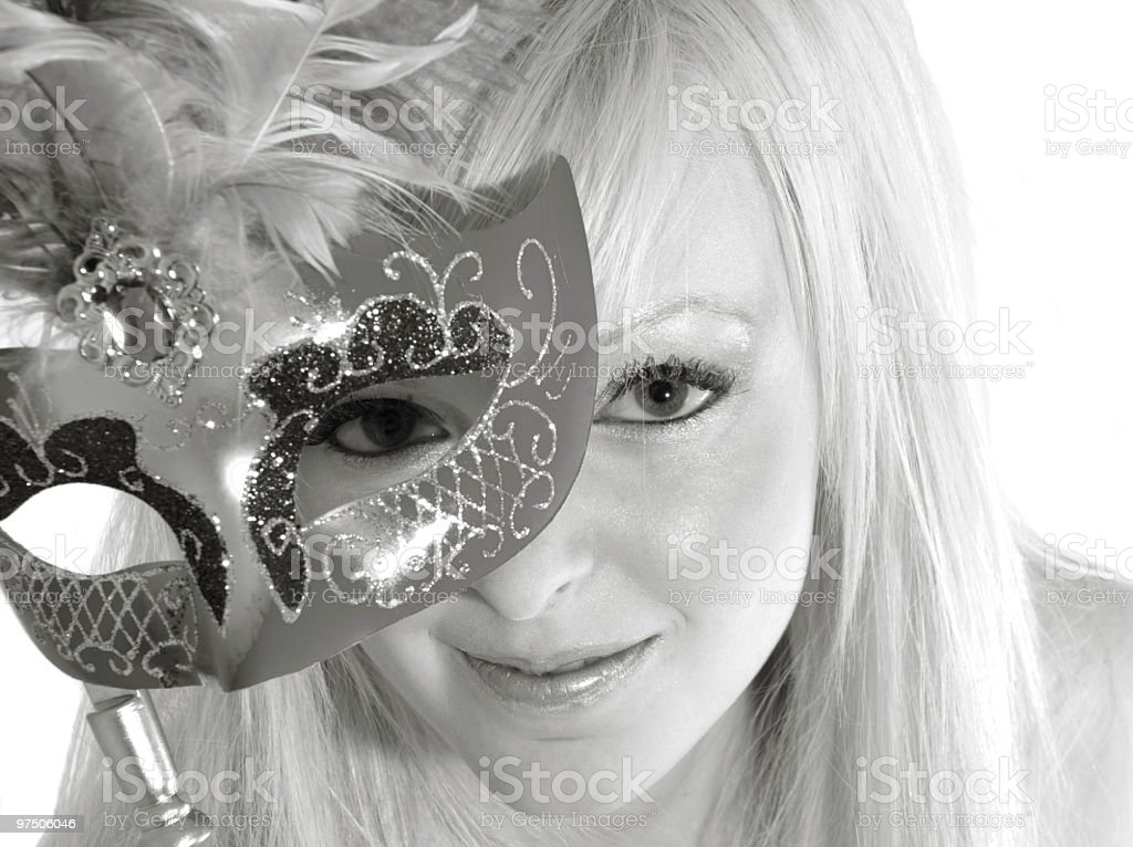 High-key black and white of young woman with mask. royalty-free stock photo