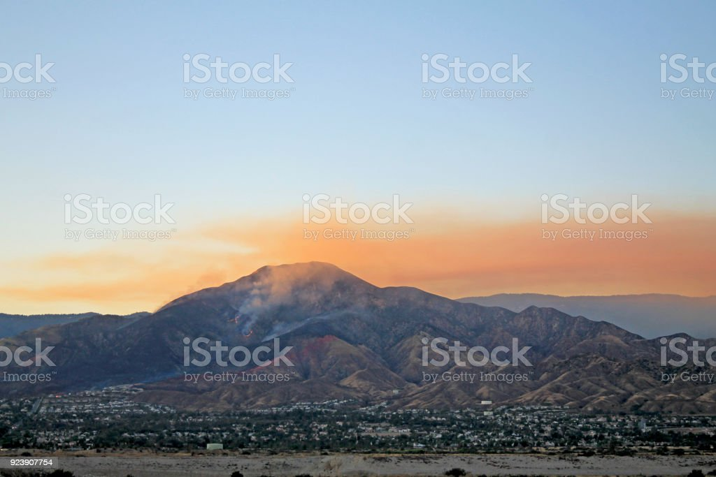 Highland Fire Fire on the mountains abouve Highland California during a sunset California Stock Photo