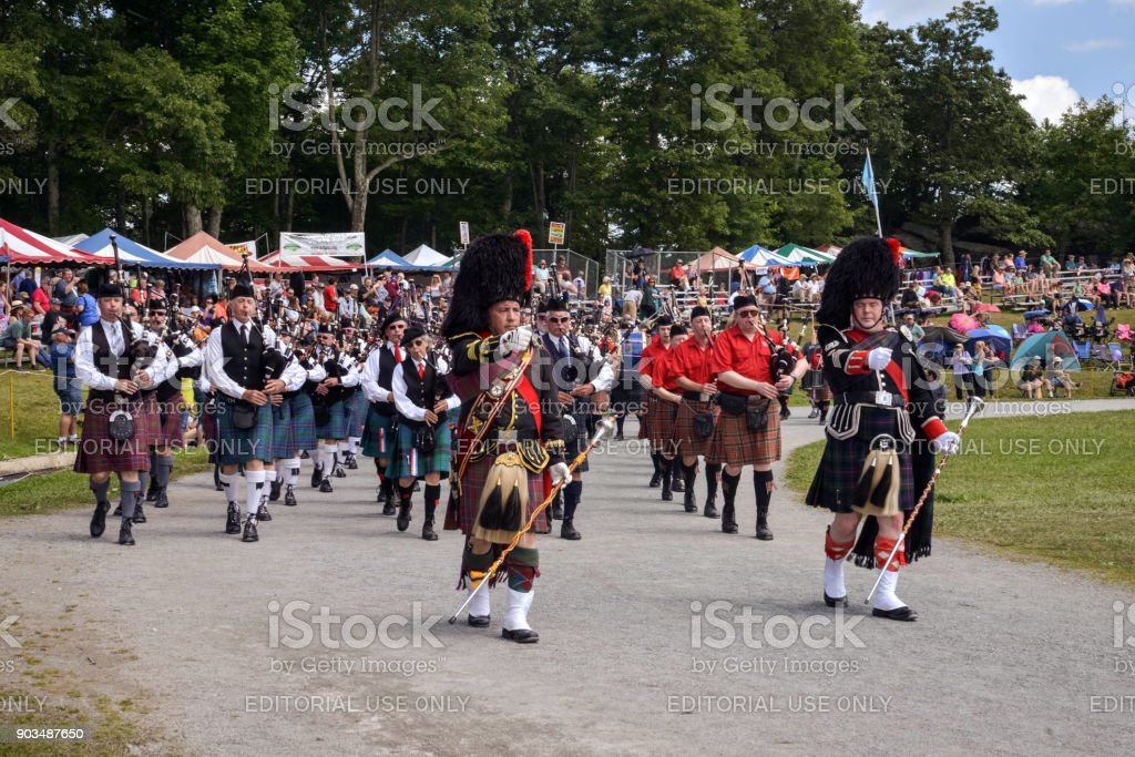 Highland Games parade in traditional dress stock photo