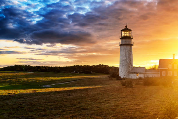 Highland Lighthouse Cape Cod Sunset The Highland Lighthouse against a beautiful sunset in North Truro Massachusetts on the Cape Cod National Seashore. cape cod stock pictures, royalty-free photos & images