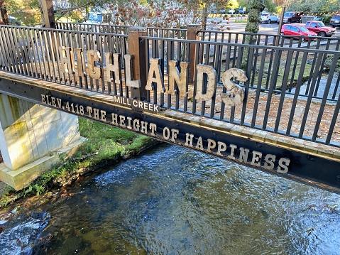 Highlands, North Carolina - October 30, 2020: Sign for Highlands Mill Creek Elevation 4188 Height of Happiness on footbridge over Mill Creek. Bridge near US Highway 64 in Highlands, North Carolina.