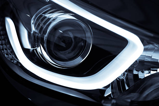 LED highlight for a new black car Detail on one of the LED headlights of a car. headlight stock pictures, royalty-free photos & images
