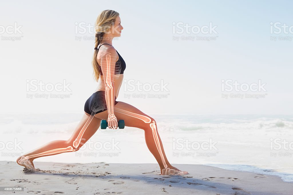 Highlighted bones of exercising woman stock photo