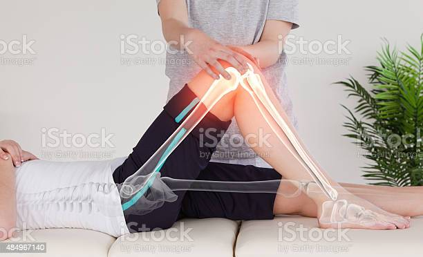 Highlighted Bones Of Woman At Physiotherapist Stock Photo - Download Image Now