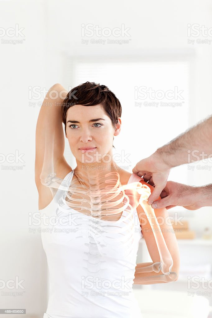 Highlighted bones of woman at physiotherapist stock photo
