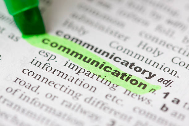 Highlighted communication in dictionary stock photo