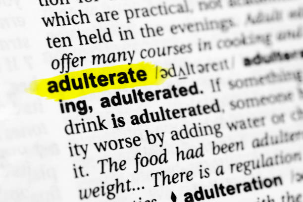 "Highlighted English word ""adulterate"" and its definition in the dictionary Highlighted English word ""adulterate"" and its definition in the dictionary. adulterate stock pictures, royalty-free photos & images"