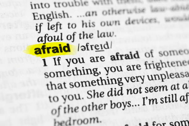 "Highlighted English word ""afraid"" and its definition in the dictionary Highlighted English word ""afraid"" and its definition in the dictionary. glossa stock pictures, royalty-free photos & images"