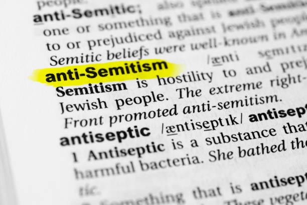 "Highlighted English word ""anti semitism"" and its definition in the dictionary Highlighted English word ""anti semitism"" and its definition in the dictionary. glossa stock pictures, royalty-free photos & images"