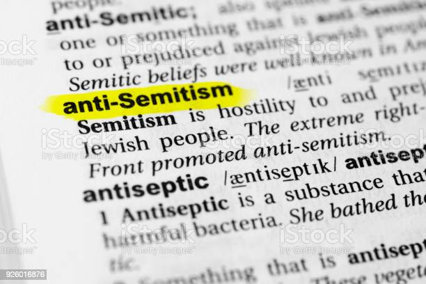 Highlighted English Word Anti Semitism And Its Definition In The Dictionary Stock Photo - Download Image Now