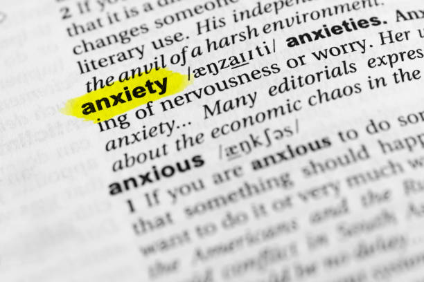 "Highlighted English word ""anxiety"" and its definition in the dictionary Highlighted English word ""anxiety"" and its definition in the dictionary. glossa stock pictures, royalty-free photos & images"