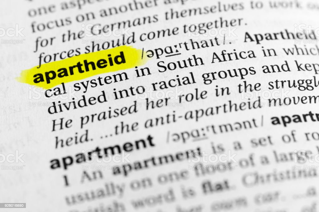 Highlighted English word 'apartheid' and its definition in the dictionary stock photo