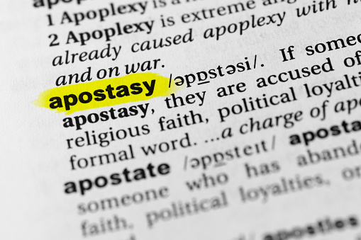 Highlighted English Word Apostasy And Its Definition In The Dictionary Stock Photo - Download Image Now