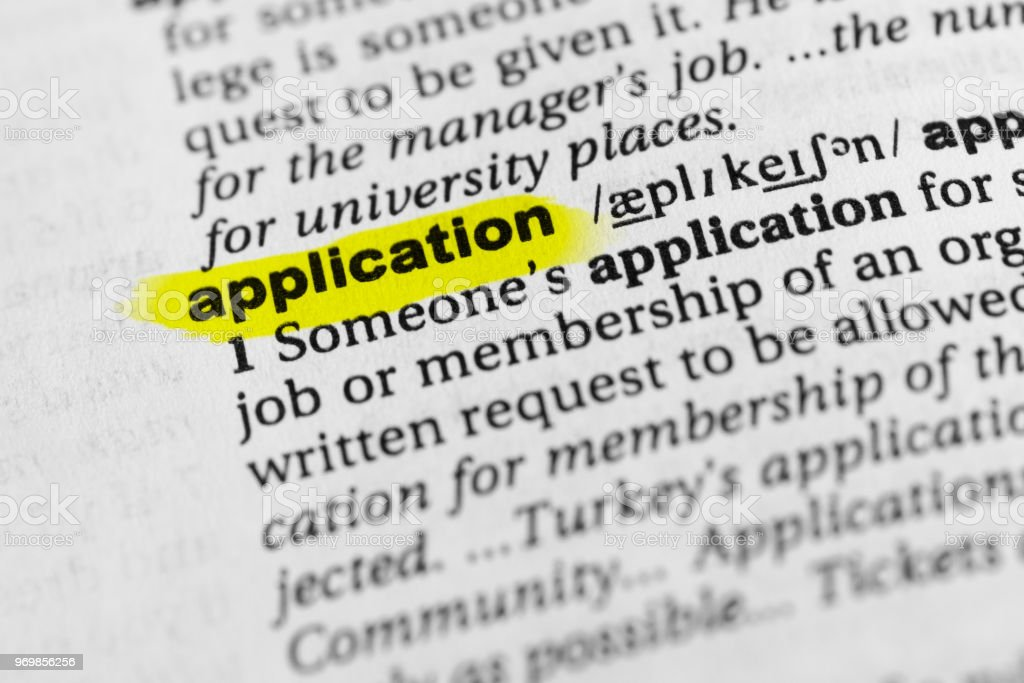 Highlighted English word 'application' and its definition in the dictionary stock photo