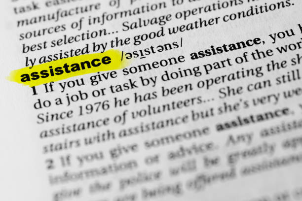 "Highlighted English word ""assistance"" and its definition in the dictionary Highlighted English word ""assistance"" and its definition in the dictionary. glossa stock pictures, royalty-free photos & images"