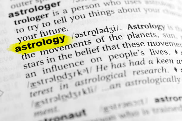 "Highlighted English word ""astrology"" and its definition in the dictionary Highlighted English word ""astrology"" and its definition in the dictionary. glossa stock pictures, royalty-free photos & images"