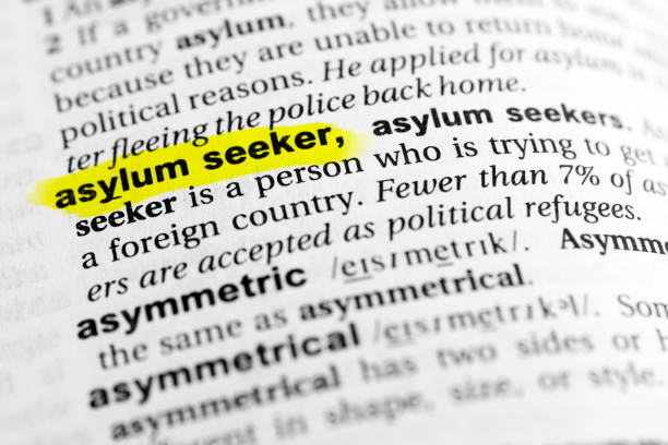 "Highlighted English word ""asylum seeker"" and its definition in the dictionary Highlighted English word ""asylum seeker"" and its definition in the dictionary. glossa stock pictures, royalty-free photos & images"