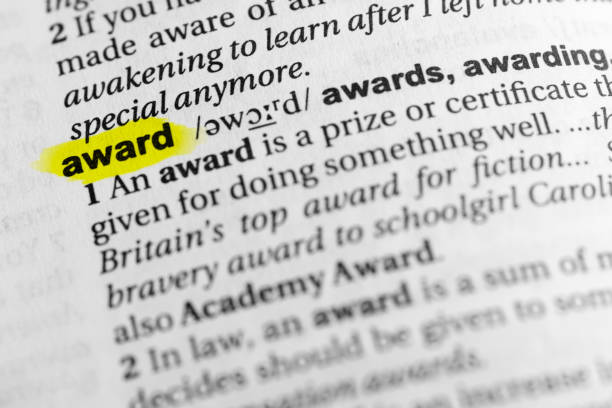 "Highlighted English word ""award"" and its definition in the dictionary Highlighted English word ""award"" and its definition in the dictionary. glossa stock pictures, royalty-free photos & images"