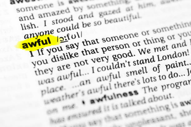 "Highlighted English word ""awful"" and its definition in the dictionary Highlighted English word ""awful"" and its definition in the dictionary. glossa stock pictures, royalty-free photos & images"