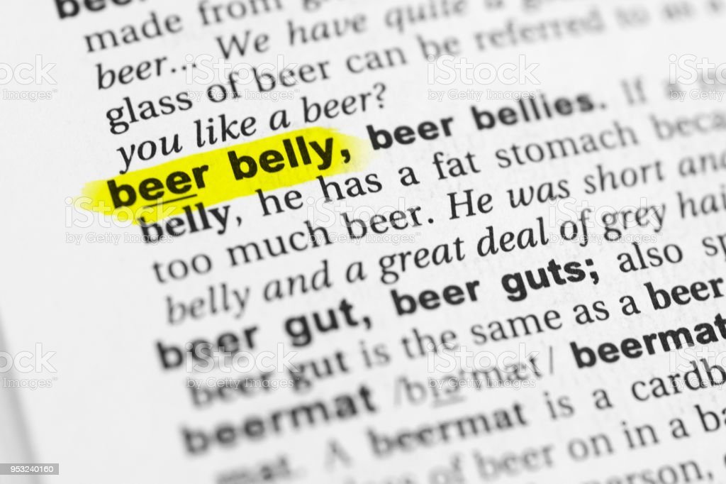 Highlighted English word 'beer belly' and its definition in the dictionary stock photo