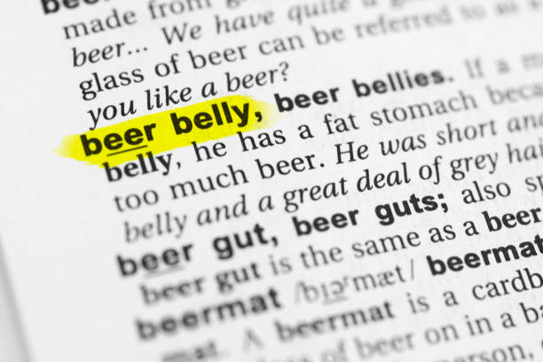 "Highlighted English word ""beer belly"" and its definition in the dictionary Highlighted English word ""beer belly"" and its definition in the dictionary. glossa stock pictures, royalty-free photos & images"