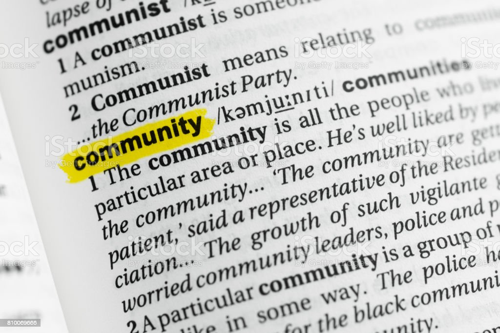 Highlighted English word 'community' and its definition stock photo