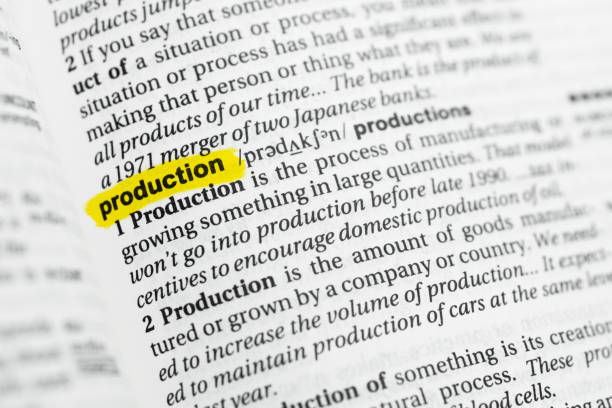 "Highlighted English word ""production"" and its definition Highlighted English word ""production"" and its definition at the dictionary. glossa stock pictures, royalty-free photos & images"