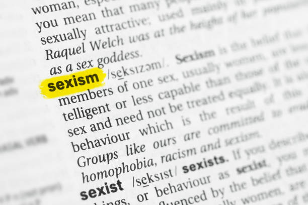 """Highlighted English word """"sexism"""" and its definition stock photo"""
