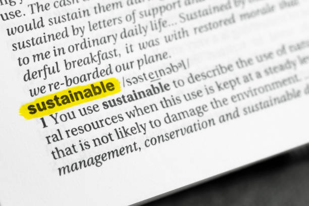 """Highlighted English word """"sustainable"""" and its definition stock photo"""