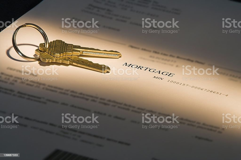 highlighted mortgage document and house keys stock photo