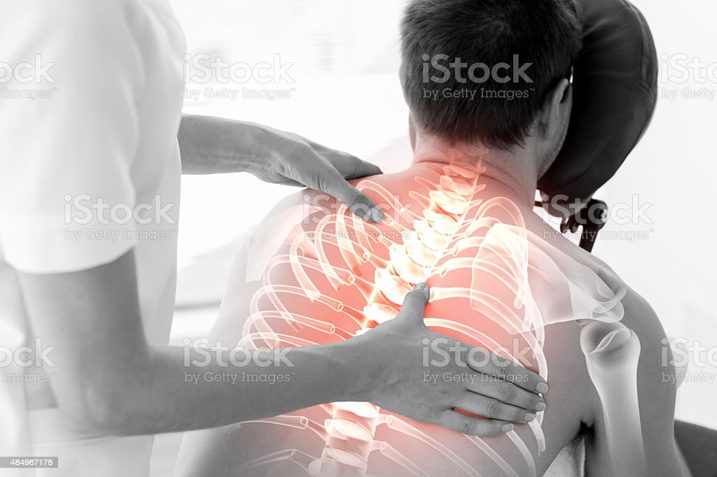 Highlighted spine of man at physiotherapy stock photo