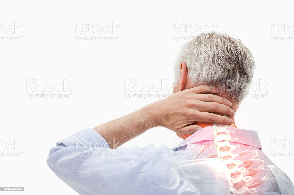 Highlighted spine pain of man stock photo