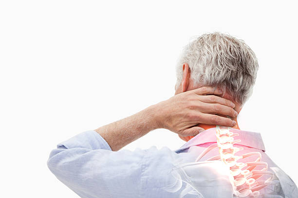 Highlighted spine pain of man Digital composite of Highlighted spine pain of man human neck stock pictures, royalty-free photos & images