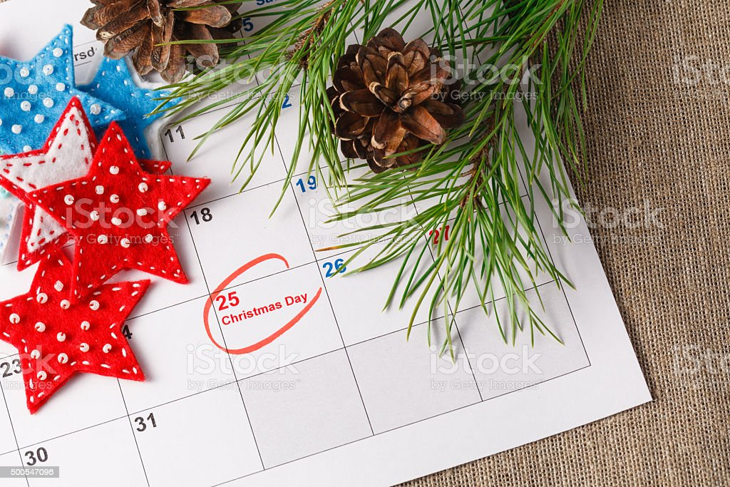 Highlighting christmas date on calendar stock photo