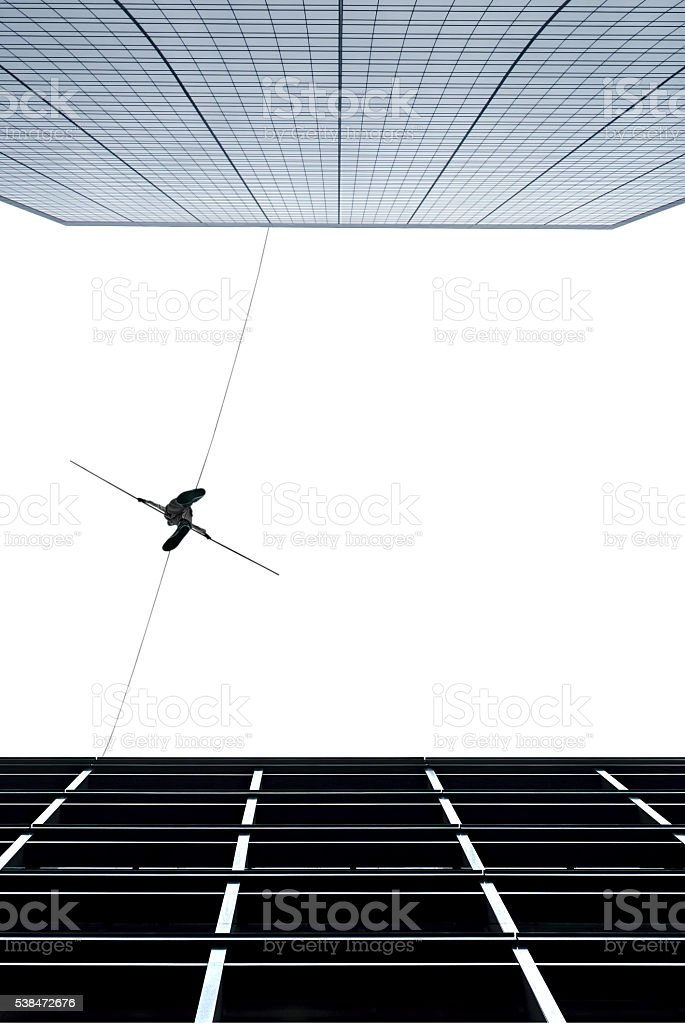 Highline walker concept of risk taking and challenge stock photo