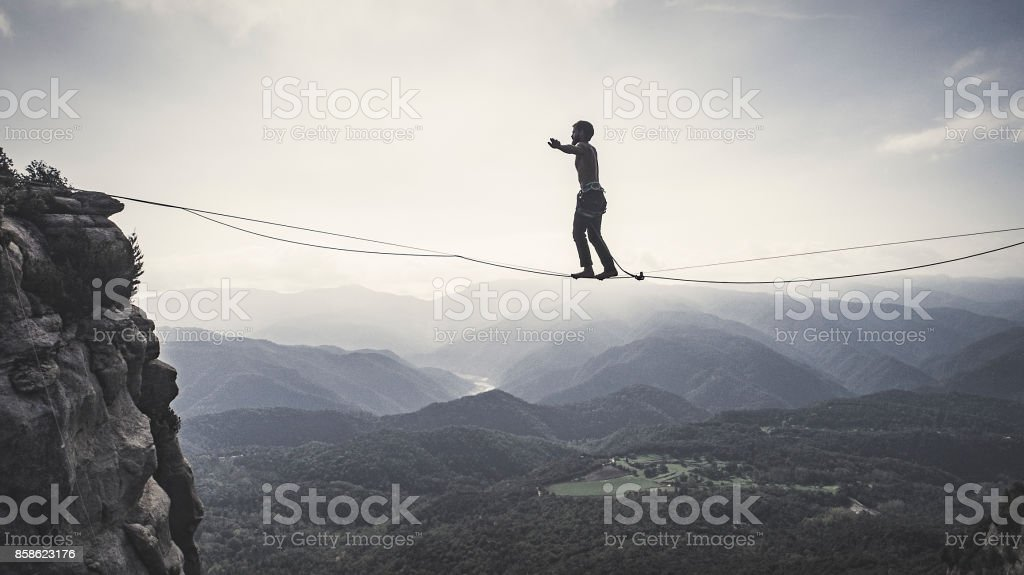 Highliner on tightrope stock photo