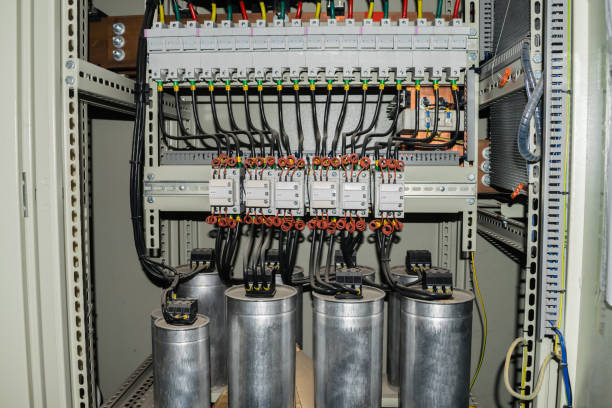 high-power capacitors installed in the electric box - capacitor stock photos and pictures