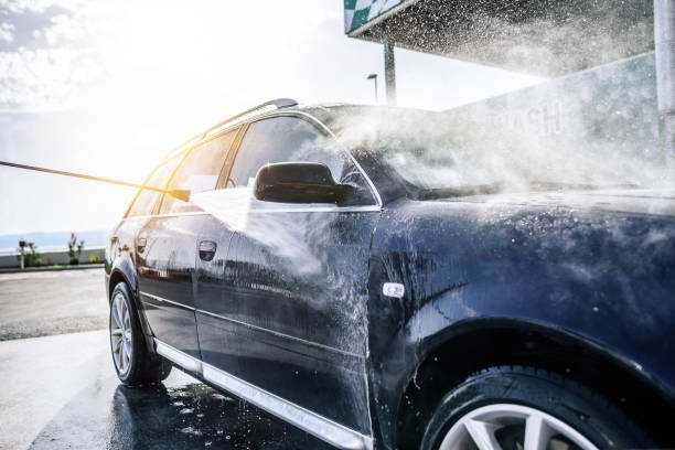 High-pressure washing car outdoors stock photo
