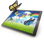 Monarch butterfly resting on a tablet computer