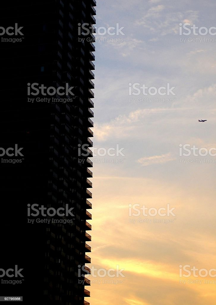 NYC High-Rise and Plane at Sunset royalty-free stock photo