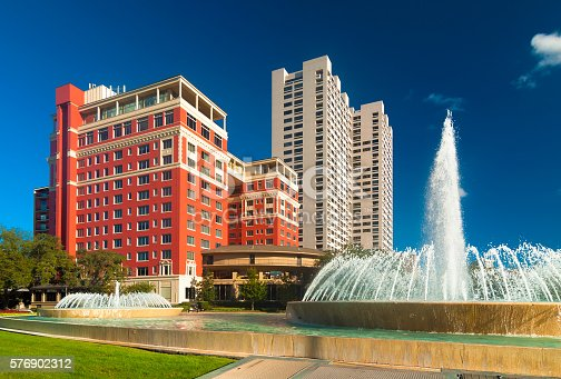 Highrise residential buildings in the Museum District in Houston, with two fountains in the foreground.