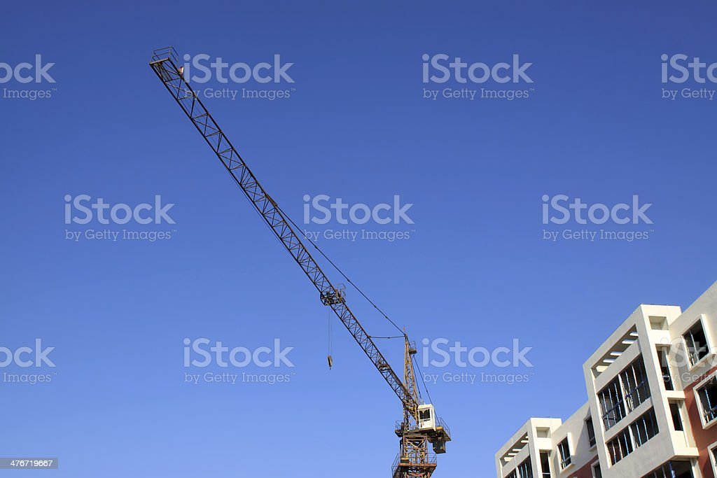 high-rise building and crane royalty-free stock photo