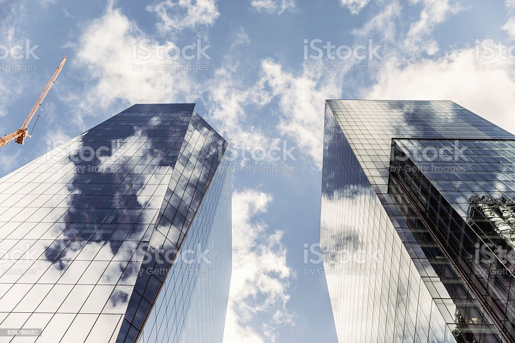 High-Rise Building with Construction Crane stock photo