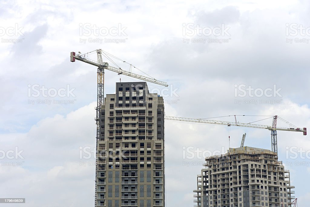 Highrise Construction Cranes royalty-free stock photo