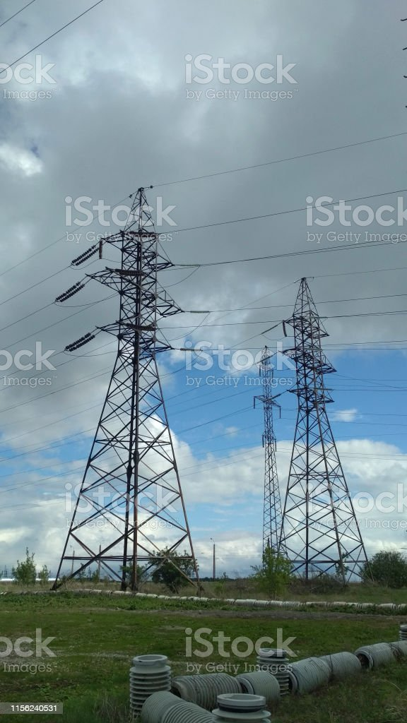 high-rise electrical networks in the field against the sky