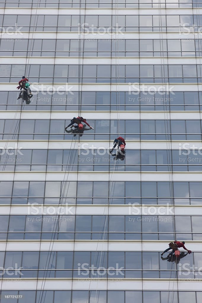 High-rise office window cleaners. stock photo