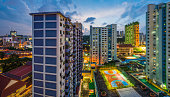 Aerial panoramic view over the crowded high-rise housing of Chinatown in central Singapore.